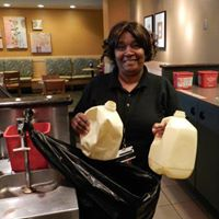 Person with milk jugs at Atlanta Airport Starbucks.jpg