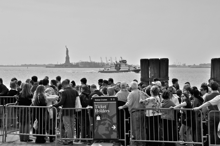 iStock-459230307 visitors to statue of liberty.jpg