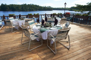 Minnesuing Acres - Dining on the deck overlooking Lake Nebagamon.png