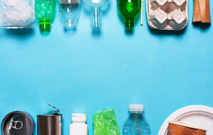 Household-waste-on-a-blue-background.-1058519598_2177x1382